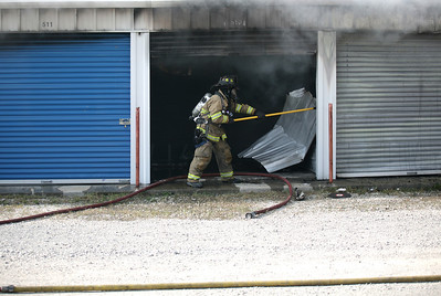 Mattoon firefighters tend to a fire at the Space Rental storage facility west of South 19th Street in Mattoon, Illinois on Thursday, July 2, 2009.  (Jay Grabiec)