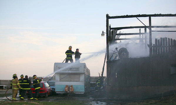 Fire fighters from several different departments work to fight a barn fire located at 10080 N. County Road 700 E in Humboldt, Illinois on Monday, March 30, 2009. (Jay Grabiec)