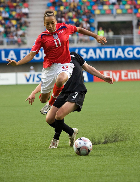 Jessica Clark (England) passes New Zealand defender Anna Greene in a qualifying match during the FIFA U-20 Women's World Cup in Santiago, Chile (2008).