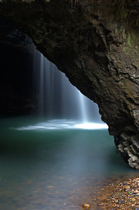 Waterfall under the natural bridge at Springbrook National Park, Queensland, Australia.