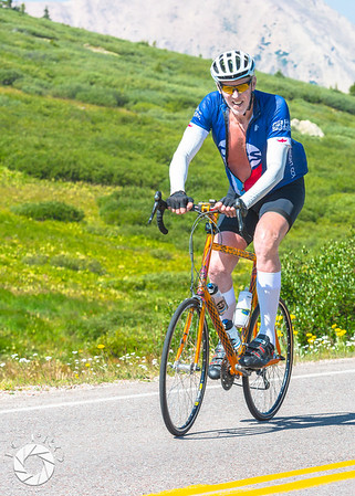 Former UCLA and NBA star Bill Walton reaches the summit of Independence Pass.