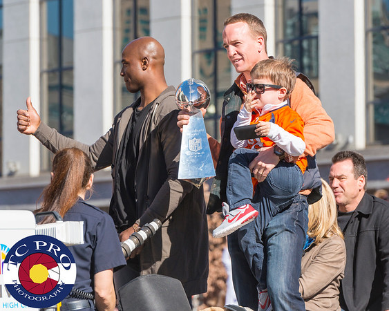 Peyton Manning with the Lombardi Trophy and DeMarcus Ware.