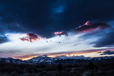 The sun sets behind the Sierra Nevada mountain range south of Bridgeport, California in February 2012.