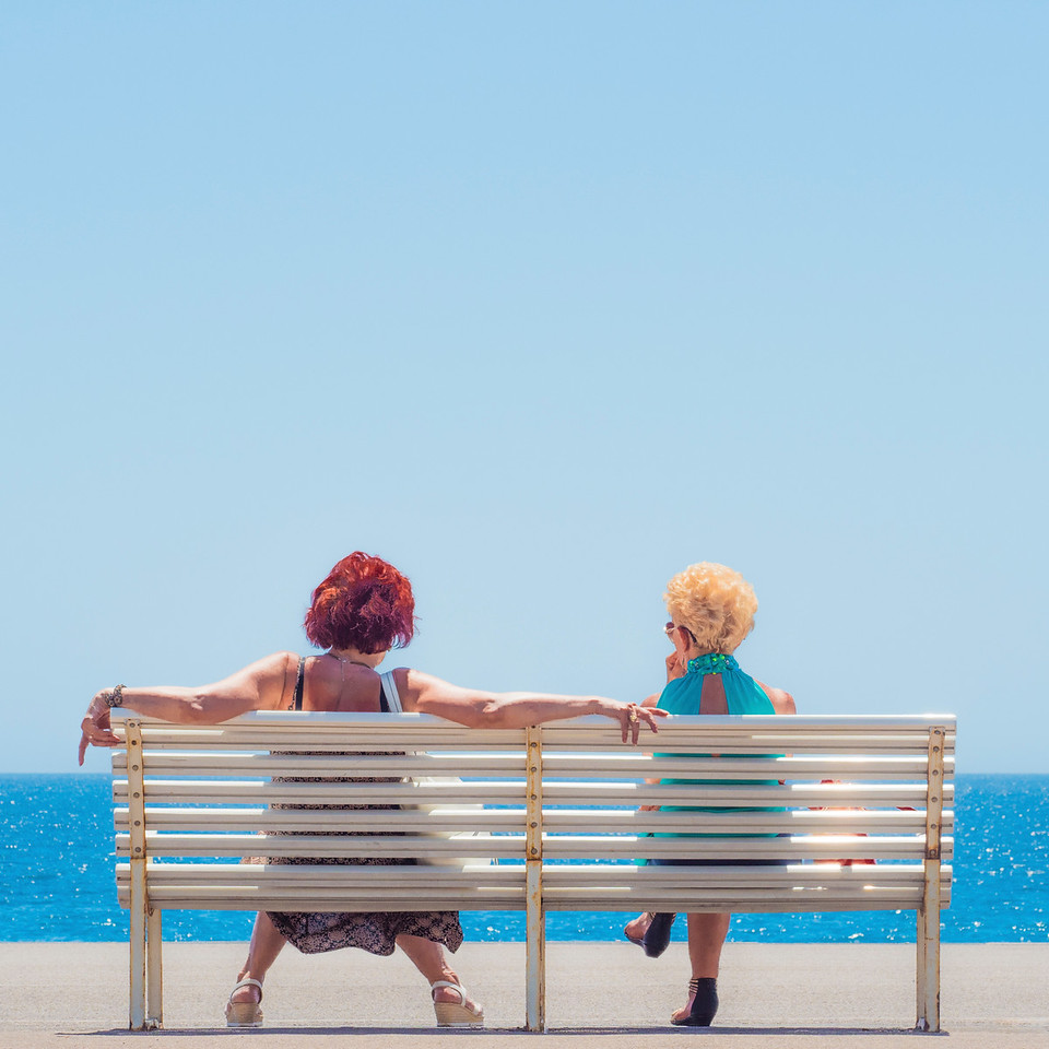 Two Ladies on White Bench