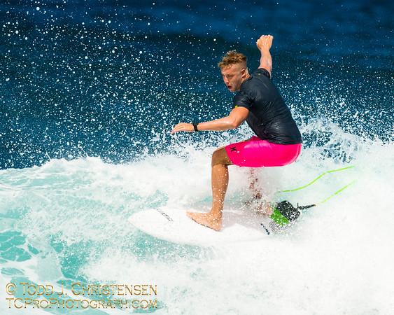 Surfer on Waves, North Shore of Oahu, HI.