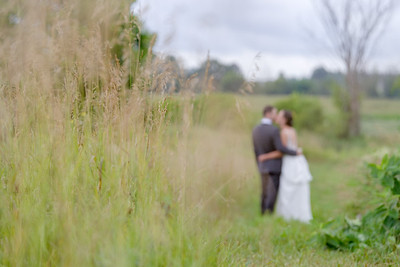 A couple exchange a kiss after their first look in Prince Edward County