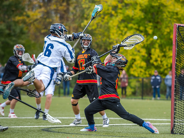 University of Toronto Varsity Blues player J. Barnable (16) scores a dramatic goal against University of Guelph Gryphons