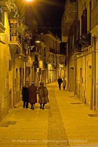 Evening stroll in the old part of the city, Cagliari, Sardinia, Italy