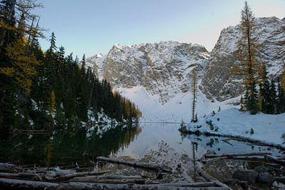 With a mirror surface, the low winter sun leaves Blue Lake in shadows.