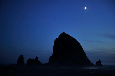 Sliver of moon over Haystack Rock