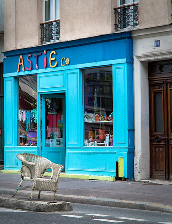 Funny shop and chair on a Paris street near Canal St. Martin