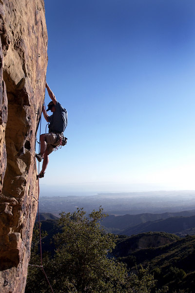 """Grib Dat Hole"" (5.11a), overlooking the town of Santa Barbara, California."