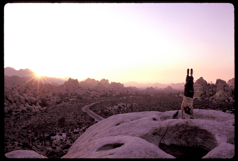 Jodi Levine performs a sunset salutation atop Intersection Rock in the heart of Joshua Tree National Park.