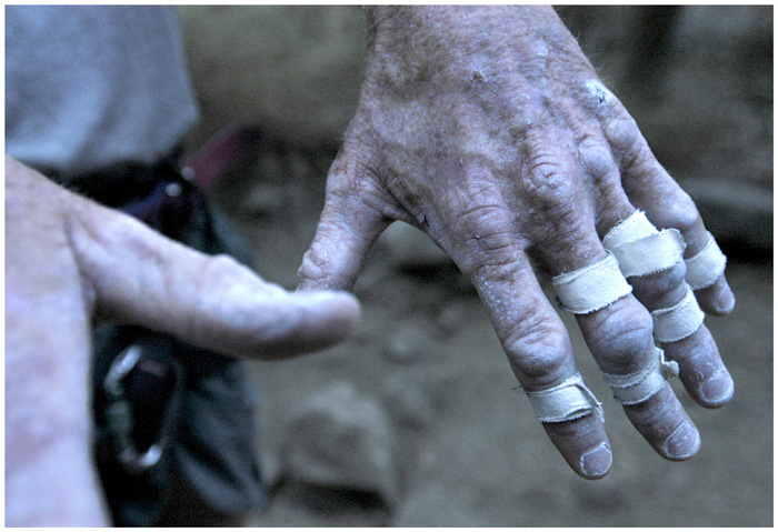 Each cut tells a story.  Each swollen joint marks another year and countless miles of rock and road.  Free solo climber Pat Shourds displays hands that betray his mere 55 years of life and speak to the wealth of experience that he has accumulated in that time.