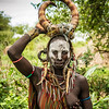 { mursi tribe mother }
