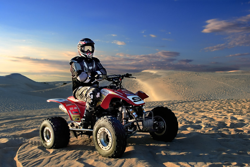 Ivan sits on his quad bike.