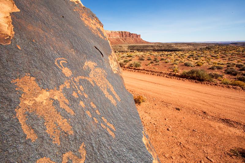 Anthropomorphs and canyon view, Basketmaker petroglyphs, Bears Ears National Monument and environs, San Juan County,  Utah