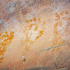 Ancestral Pueblo baby footprints overlaying faded white adult handprints , Bears Ears National Monument and environs, San Juan County, Utah