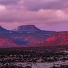Purple sunset light on a snowy Bears Ears formation, Bears Ears National Monument, San Juan County, Utah