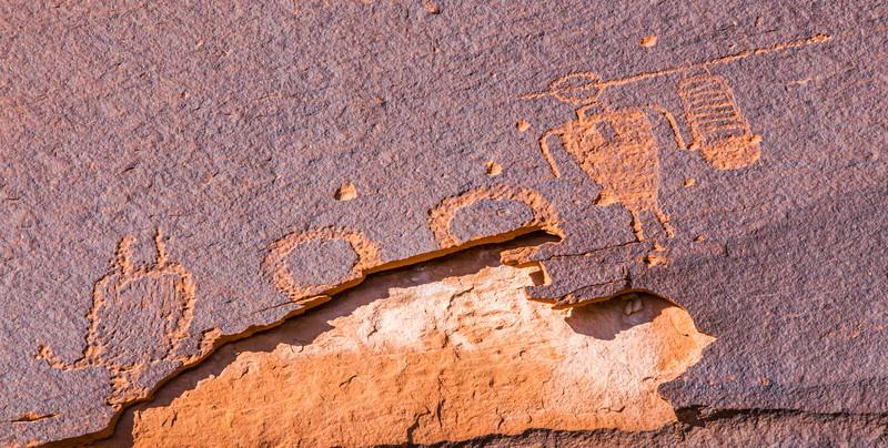 Basketmaker lobed circles, atlatl, and upside-down figure petroglyphs, Bears Ears National Monument and environs, San Juan County, Utah