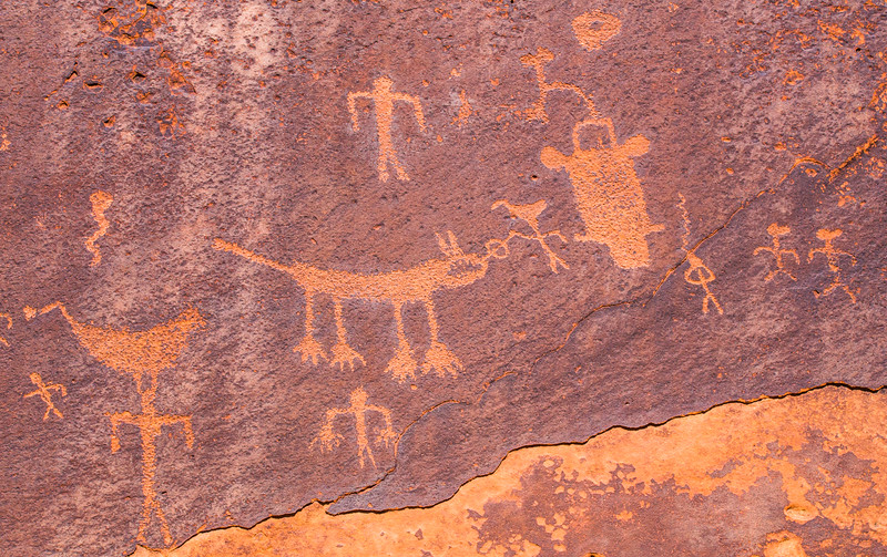 Wide view of Basketmaker petroglyph panel depicting a mountain lion being hunted with an atlatl, Bears Ears National Monument and environs, San Juan County,  Utah