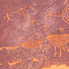 Horizontal view of Basketmaker petroglyphs depicting a hunting scene, Bears Ears National Monument and environs, San Juan County,  Utah