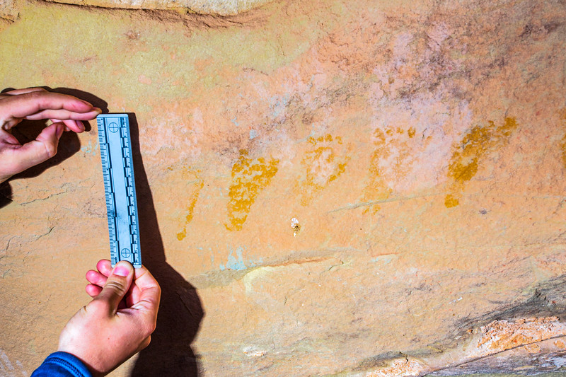Ancestral Puebloan baby footprints overlaying faded white adult handprints, Bears Ears National Monument and environs, San Juan County,  Utah