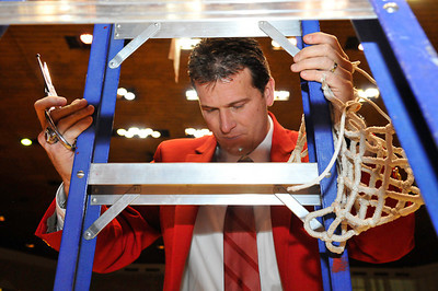 UNIVERSITY OF NEW MEXICO MEN'S BASKETBALL COACH, STEVE ALFORD, CUTTING DOWN NETS UPON WINNING THE MOUNTAIN WEST CONFERENCE REGULAR SEASON CHAMPIONSHIP BACK-TO-BACK, 2010