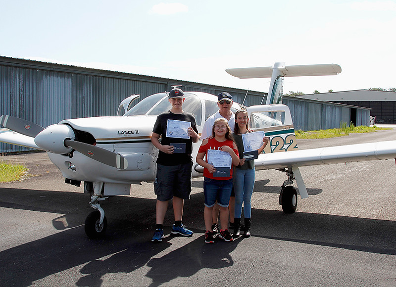 DON WHITING AND PASSENGERS WITH YOUNG EAGLES CERTIFICATES - PIPER LANCE II