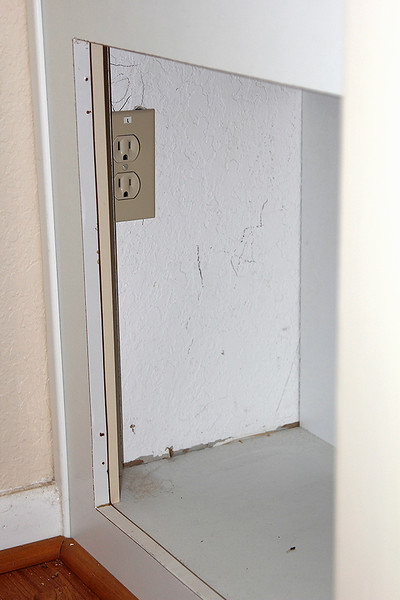 LEFT ALCOVE COMPUTER CUBBY - 110 VOLT WALL JACK AVAILABLE INSIDE