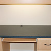 RIGHT ALCOVE CONSOLE FORMICA TOP SHOWING CABLE HOLE