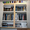 LEFT ALCOVE CABINET HOLDS OUR DVD COLLECTION - POISON BOTTLE COLLECTION DISPLAYED ON TOP