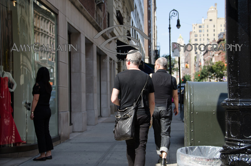 Male Couple admiring gown while walking