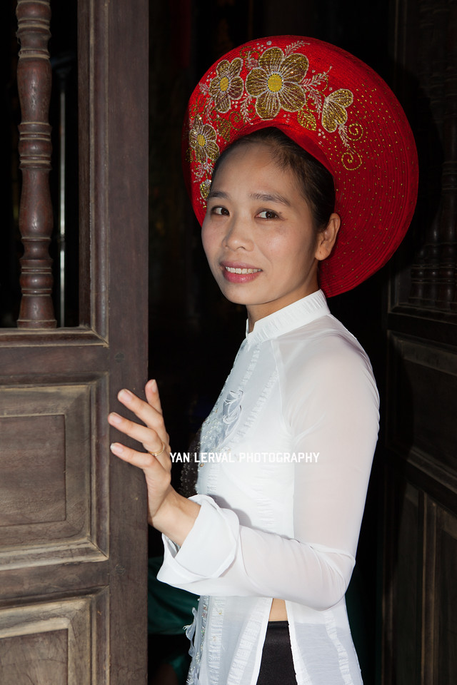 Woman wearing a traditional Ao Dai in Hoi An, Vietnam