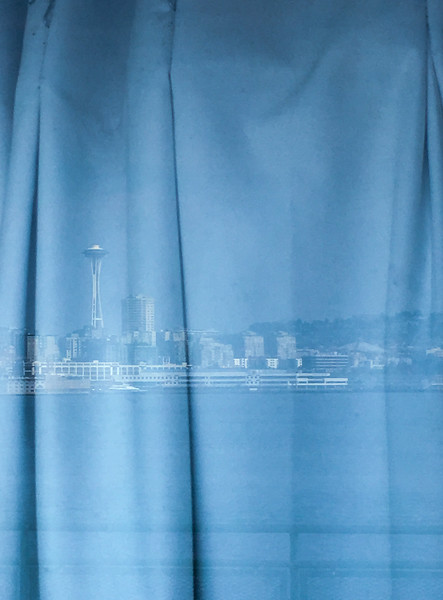 Seattle Space Needle reflection in Bainbridge Ferry window, WA USA