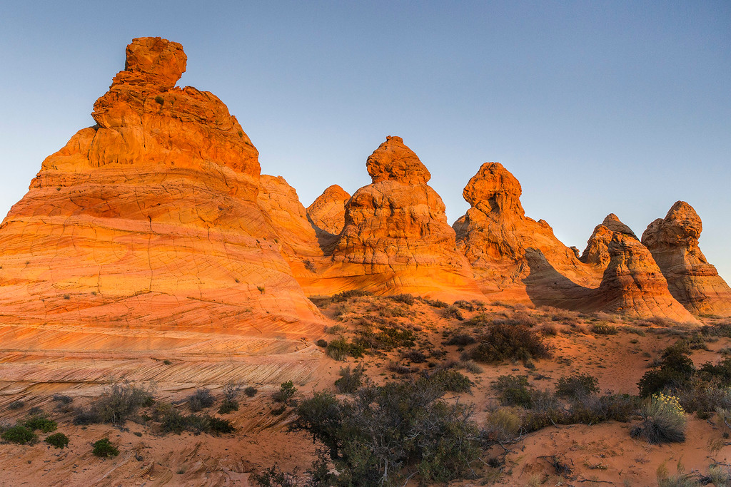 First light glow on buttes in Coyote Buttes South, Vermillion Cliffs National Monument, Arizona
