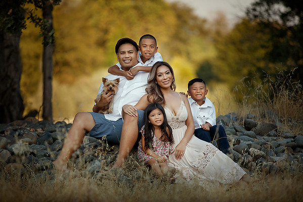 Sacramento family photographer during outdoor portrait session. Fall Family portraits in a park.
