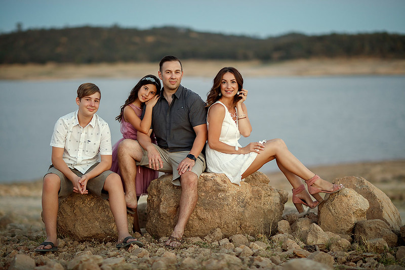 Family portrait photography at outdoor location by Sacramento top family photographer Sergey Bidun. Summer photo session by Folsom Lake.