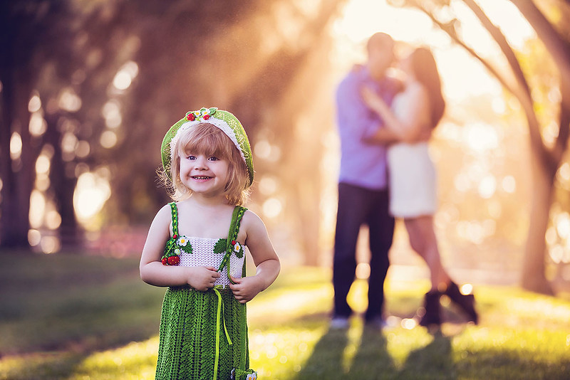 Family portrait photography at outdoor location by Sacramento top family photographer Sergey Bidun. Summer family portraits in a park