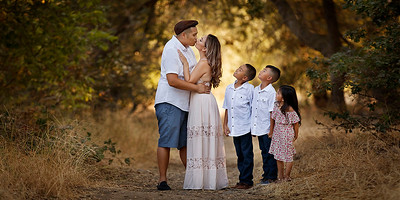 Sacramento family photographer during outdoor portrait session. Family pictures at American River park.