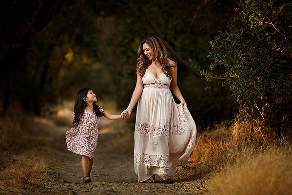 Family portrait photography at outdoor location by Sacramento top family photographer Sergey Bidun. Mother and daughter portrait at sunset.