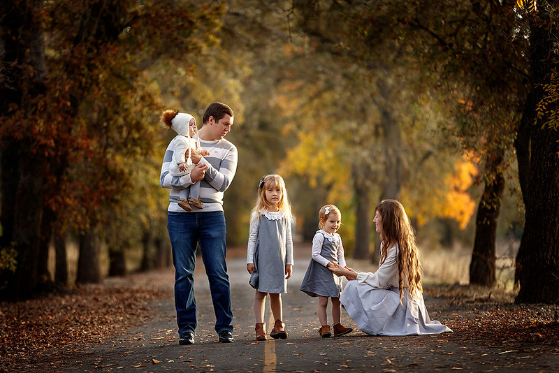 Family portrait photography at outdoor location by Sacramento top family photographer Sergey Bidun. Golden fall family portraits with three little girls.