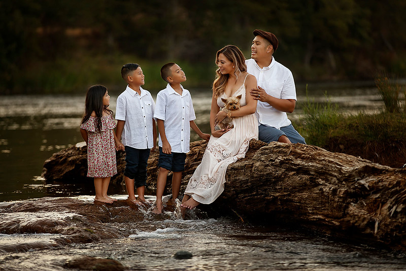 Family portrait photography at outdoor location by Sacramento top family photographer Sergey Bidun. Fun family portrait with three children and a dog.