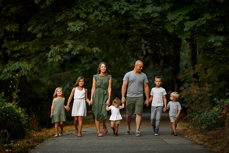 Family portrait photography at outdoor location by Sacramento top family photographer Sergey Bidun. Family session at a beautiful park.