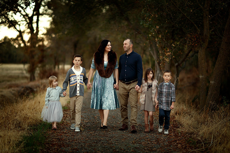 Family portrait photography at outdoor location by Sacramento top family photographer Sergey Bidun. Fall family photo session for holiday cards.