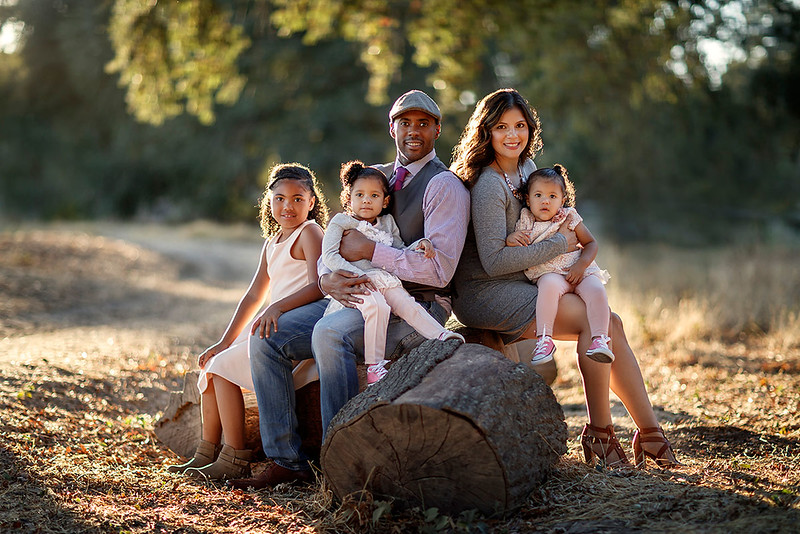 Family portrait photography at outdoor location by Sacramento top family photographer Sergey Bidun. Golden-hour fall portraits of family.