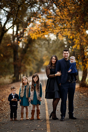 Family portrait photography at outdoor location by Sacramento top family photographer Sergey Bidun.  Stylish family with four children at a park.