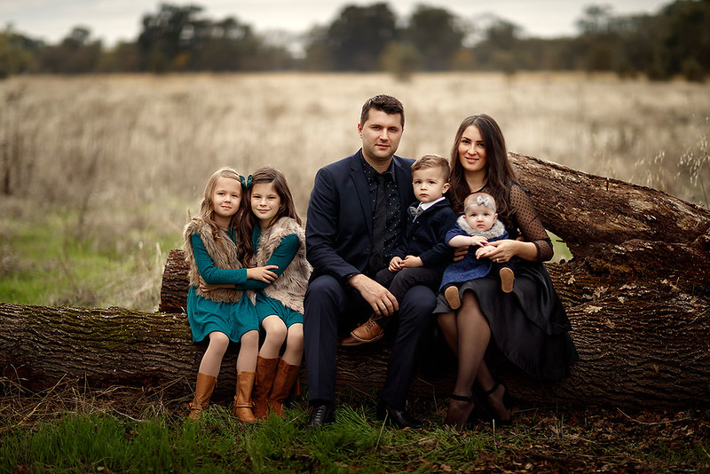 Family portrait photography at outdoor location by Sacramento top family photographer Sergey Bidun. Golden fall portraits of family.