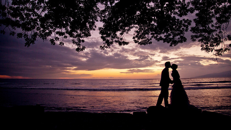 Sunset Silhouette of Bride and Groom on Their Wedding Day