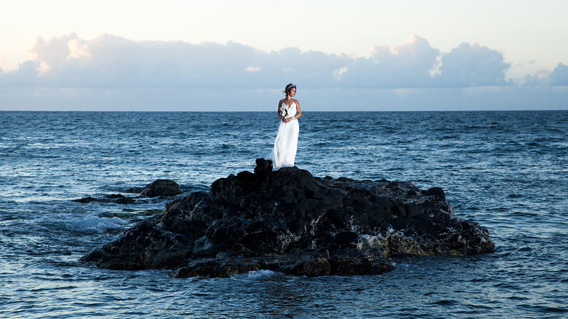 Bridal portrait on Lava Rocks in the middle of the Pacific Ocean